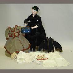 Fine Simonne bisque head fashion doll with trousseau