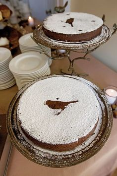 Simple & elegant. Make a diecut of something pretty, set it on the cake, sift powdered sugar over, remove diecut, DONE!