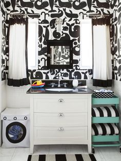 Whale wallpaper punches up a black and white bathroom. #hgtvmagazine http://www.hgtv.com/decorating-basics/the-makings-of-a-fun-house/pictures/page-8.html?soc=pinterest