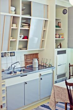 These angled cupboards provide great storage and a personal touch - could also be applied in the kitchen design in a Tiny House...