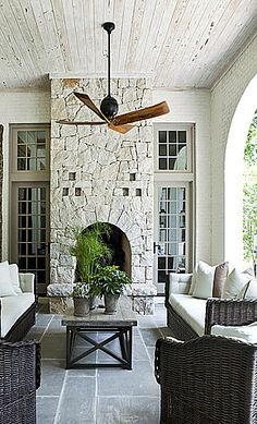 another great covered porch w/outdoor fireplace