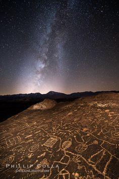 The Milky Way at Night over Sky Rock.  Sky Rock petroglyphs near Bishop, California. Hidden atop an enormous boulder in the Volcanic Tablela...