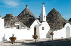 Trulli houses in Puglia, Italy.  Need to stay in one of these on our next visit to see the family.
