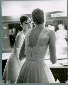 Grace and Audrey talk backstage in 1956.
