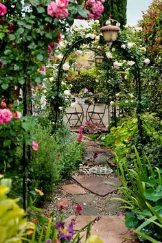 For a flower lover, what better place to sit could there be than at this bistro set, enjoying the view through a series of rose-covered arbors?   Photo: Mark Lohman   thisoldhouse.com