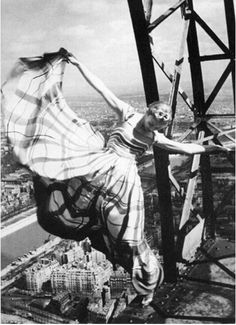 Lisa Fonssagrives in a Lucien Lelong gown swinging off the Eiffel Tower. Photo by Erwin Blumenfeld for Vogue May 1939. eiffel tower, lucien lelong, vintag fashion, lisa fonssagr, vintage fashion photography, dress, pari, erwin blumenfeld, fashion photographi