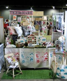 Tiger & Hare: market display. Love the little house, love the way she is hanging the onesies