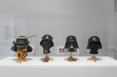 Vader Helmet: perhaps the strangest narrative is presented in a case which shows a trajectory from Japanese helmet to first world war gas mask to Darth Vaders helmet and then to the helmets of the Fedayeen Sadaam.