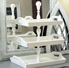 Trays and repurposed wood candle sticks. Shabby Sweet Cottage: Stacked Trays.........good bathroom vanity storage
