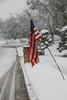 Winter - American Flag hangs proudly in the snow.