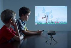 TouchPico: handheld Android projector throws 80-inch touchscreen