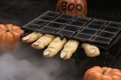 Shape these cheesy crackers into creepy Witch's Fingers, pressing a sliced or skinned almond onto the end of each one to make the nail.