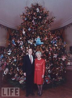1991 Barbara Bush tree featured needlepoint tree ornaments, red glass balls, a turn-of-the-century needlepoint village and needlepoint figurines from Noah's Ark.