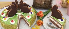 This homemade Easter Cake is made with a shortcrust and a sponge cake. Filled with whipped cream, mandarins, and cherry jam. Step by step instructions.