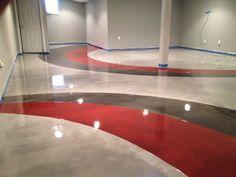Red, gray design over pearl Metallic Marble epoxy basement flooring.