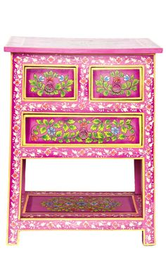 Cabinet Almirah | Pretty cabinet painted a deep pink and covered with flowers and foliage. 2 smaller drawers at the top with a single one below. Painted metal drawer pulls. Open storage space under drawers. Fairtrade product. Designs and colours may vary slightly from image shown due to handcrafted quality. Small imperfections in paintwork are part of the design | Plümo