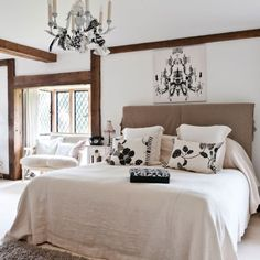 Simple but accented white bedroom.