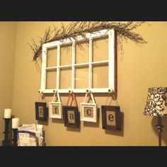 An old window, cute drawer pulls, frames with ribbon, and burlap behind the letters! Super easy!