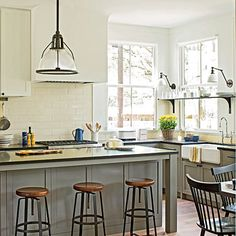 This kitchen's sturdy island features an equally hardy honed Absolute Black granite countertop.