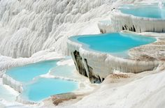 Pamukkale, TurkeyThe bright blue pools of Pamukkale in Turkey look as if they're sitting atop piles of snow or cotton (hence the name, which is Turkish for Cotton Castle), but in reality the natural pools and terraces are formed by calcite deposits. The thermal pools, with temperatures of around 95 degrees and a number of healing minerals, are thought to have therapeutic qualities, so be sure to take a dip in the Sacred Pool if you visit. Ancient emperors and kings used to vacation at the pool