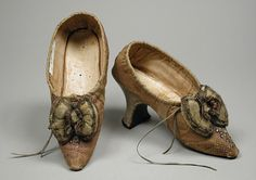 Pair of Woman's Indoor Slip-on Shoes Probably France, circa 1785-1790. Metal thread and sequin embroidery on silk damask.
