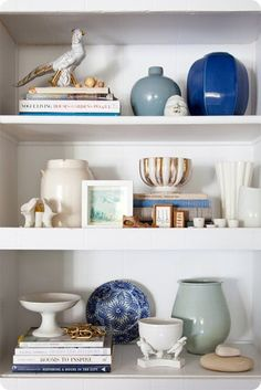 Love the balance and shapes: pretty bookshelf staging