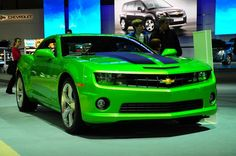 Lime green Camero with black racing strips.