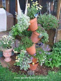 Tipsy flower garden (great idea for an herb garden)