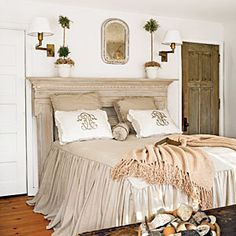 Beautiful bedroom. A damaged mantel serves as a headboard in the master bedroom.