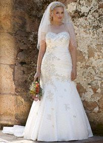 David's Bridal   Satin wedding gown features gorgeous beaded lace applique for a high end look.  Ruched bodice and slim silhouette help to accentuate your curves.  Lace up corseted back promises a perfect fit.  Chapel train. Sizes 16W-24W.