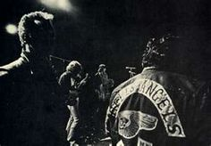 Mick Taylor on Gibson SG guitar. Angels guarding the stage. (altamont, ca)