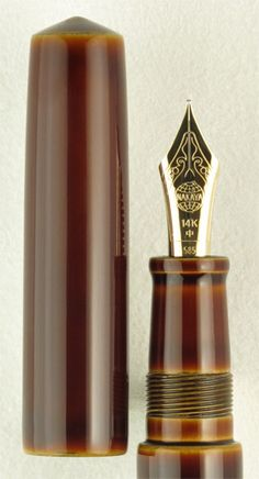 Nakaya Piccolo Cigar Shiro-tamenuri. Compact in shape but not in style, the Nakaya Piccolo Cigar Shiro-tamenuri fountain pen seems to be illuminated from within. Rich amber color fills the Piccolo between two slightly domed cap ends, while layers of gold and amber peek through at the seams. A 14k gold nib complements the warm tamenuri hues. Also available in the Writer model (with clip). $650