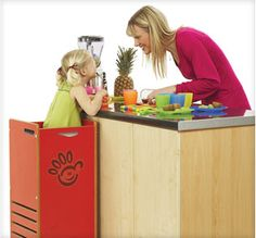 So smart, contain the kiddos while they help in the kitchen.