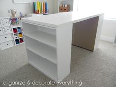 DIY Craft Table / (2) $15 Walmart bookshelves and sheet of cabinet grade plywood.