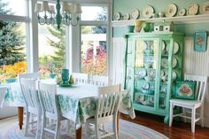 love that painted cabinet. love the beadboard. love the plate rail.