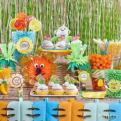 A jungle-themed baby shower is the perfect excuse to go beyond pink and blue ... with a ferociously fun candy buffet in tropical colors!