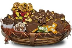 Harvest the sweets with Sugar Plum's Chocolate Covered Snacks Basket! This delightful Chocolate gift basket comes filled with a pail of chocolate covered pretzels, chocolate covered caramel corn, 3 assorted flavors of Ch'up Cakes, 1 acorn box filled with mini chocolate acorns & leaves, green tea candies, and 2 chocolate maple leaves with sprinkles. Giving the gift of a chocolate gift basket will warm someone's heart for sure!