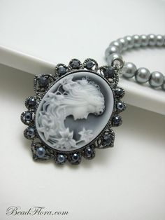 Cameo on silver pearl chain.
