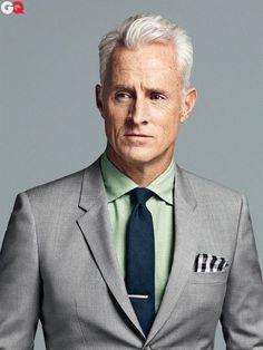 grey suit, blue tie.