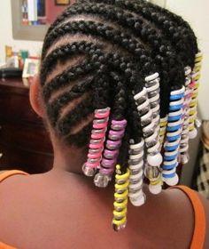Side braided hairstyle African American girls hair holders