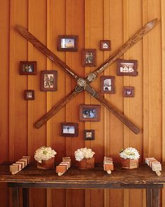 Antique skis hang above escort cards for a cozy vibe