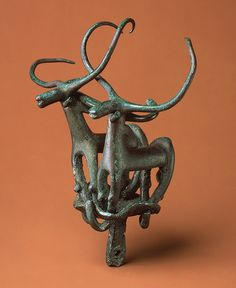 During the Early Bronze Age in Central Anatolia (Turkey) 3000–2000 BCE, a number of nonliterate, discrete cultures with little contact with urban Mesopotamia produced spectacular metal vessels, jewelry, weapons, and musical instruments buried with their rulers. This pair of long-horned bulls were cast separately of arsenical copper,  held together by extensions of their front and back legs, bent around the plinth.