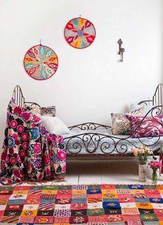love the dark bronze iron bed with the pop of orange and magenta
