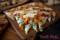 A refined take on pizzas... Piadina pizzetta flatbreads with artisan cheeses, grilled local seasonal vegetables, & caramelized onions. Ravishing Radish Catering. Barbie Hull Photography.
