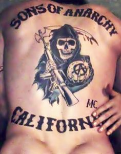 Charlie Hunnam . . . Okay, I don't care that this tattoo isn't real. This is one of my favorite scenes from the show.