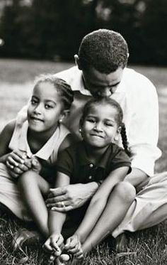 President Barack Obama with his daughters