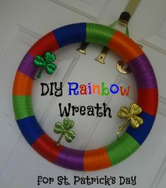 DIY Rainbow Wreath for St. Patrick's Day via www.jmanandmillerbug.com #crafts #diy #stpatricksday