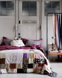 I like how an old quilt can be incorporated into a modern room