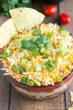 A spicy and packed enchilada dip that is vegetarian. Packed with black beans, refried beans, corn, salsa, enchilada sauce, and an array of ...