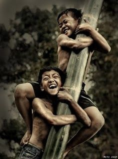 Laughing. This reminds me of my husband and his brother playing in the Philipines